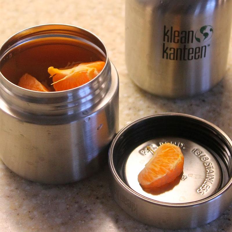 fiambrera hermética redonda con mandarina